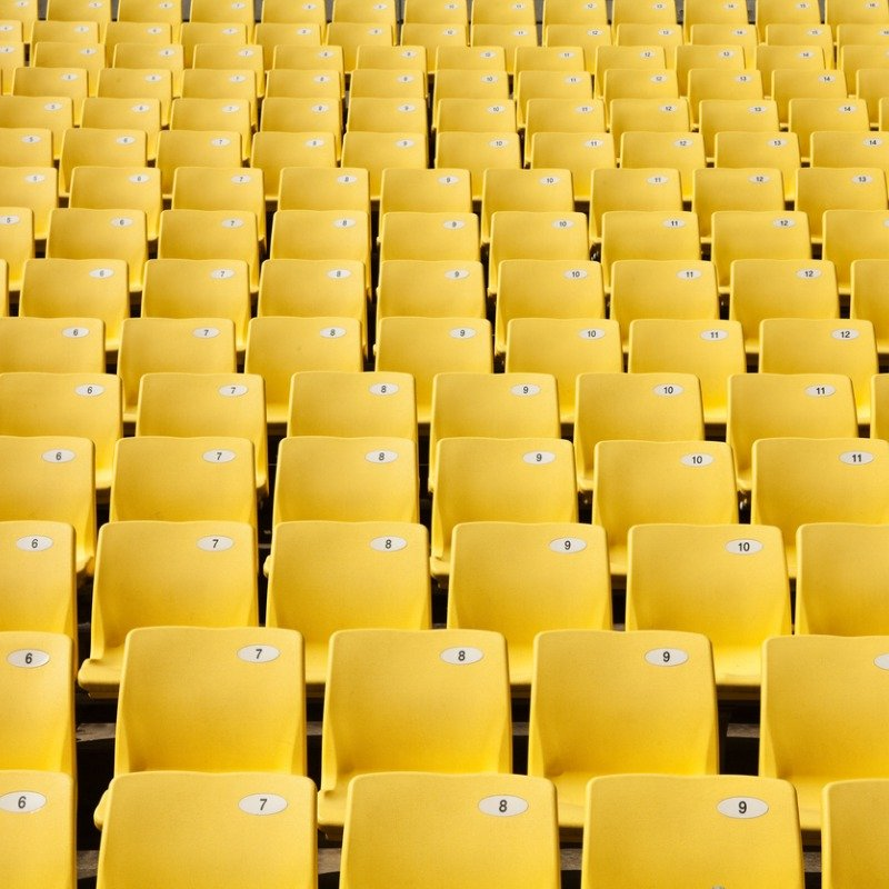 Rows of yellow stadium seats