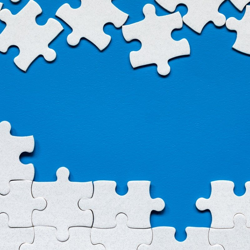 Blue background with white puzzle pieces