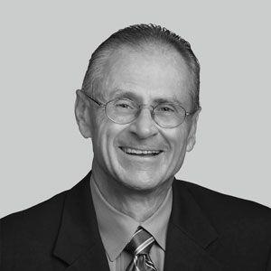 Paul F. Macielak headshot in black and white